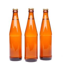 Three brown beer bottle