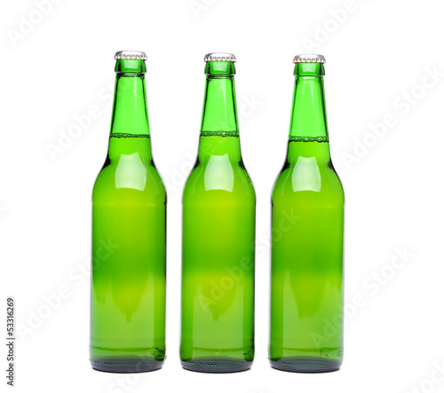 Three green beer bottle