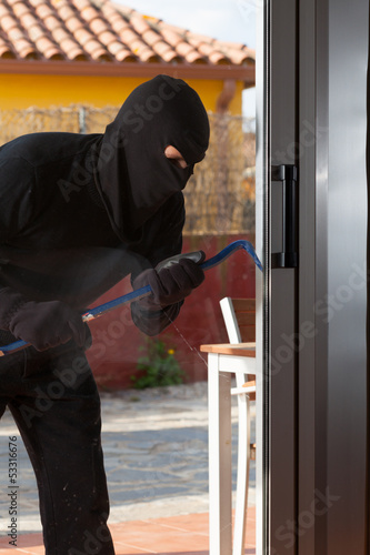 Thief stealing from a house