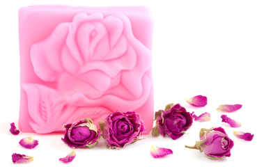 Pink bar of natural rose soap with dried purple rose buds