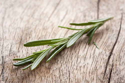 Rosemary twig on wooden table