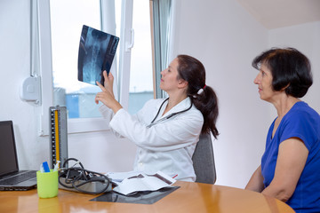 Doctor checking X-ray image