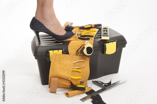 Toolbox with woman's high heel shoe