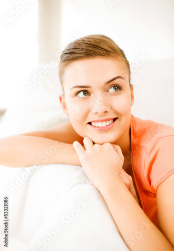 smiling woman lying on the couch