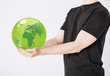 man holding green sphere globe