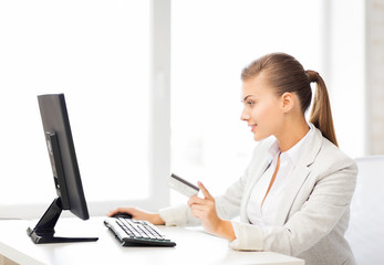 businesswoman with computer using credit card