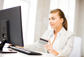 businesswoman with laptop using credit card