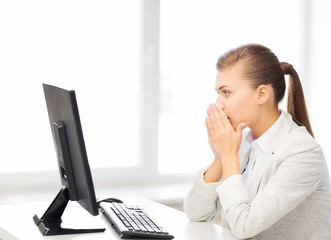 stressed student with computer in office