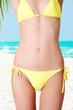Sexy belly of fit  woman in bikini.