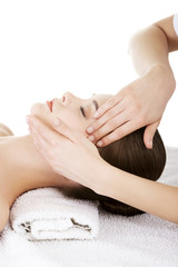 Relaxed woman enjoy receiving face massage at spa saloon
