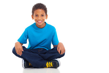 african american boy sitting on white background