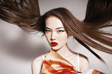 Photo of beautiful asian woman with magnificent hair. Fashion ph