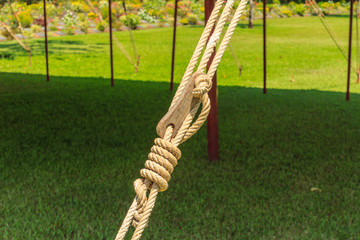 Natural fiber ropes and wooden tackle blocks for bind tent.