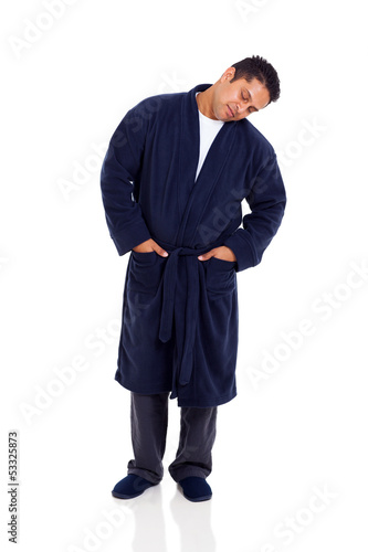 sleepy indian man standing on white background