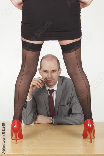 Female assistant seducing her male boss in office