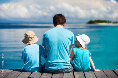 Father and kids enjoying ocean view