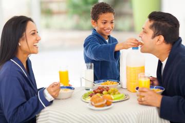 little boy feeding his father fruit