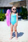 Fototapety Little girl at tropical beach