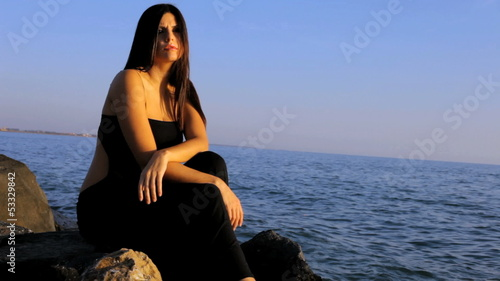 Beautiful feale model posing sad on the beach