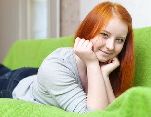 young girl relaxing on couch