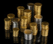 Many coins in columns isolated on black