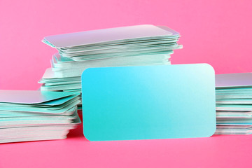 Stacks of business cards, on color background