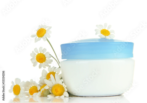 Cosmetic cream with wild camomiles, isolated on white