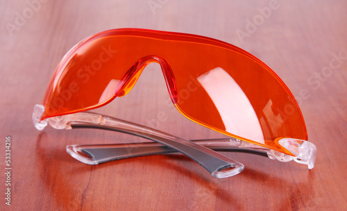 Glasses scientist on wooden background