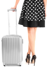 Girl's legs with suitcase isolated on white