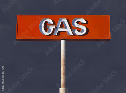 Vintage Desert Neon Gas Sign with Storm Sky