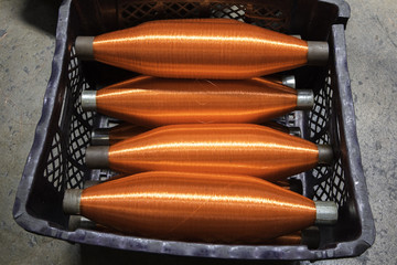 Bobbins with orange ropes