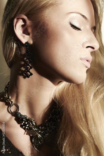 Beautiful blond young woman closed eyes. shade from the sun