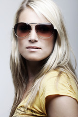 Gorgeous female model posing in sunglasses