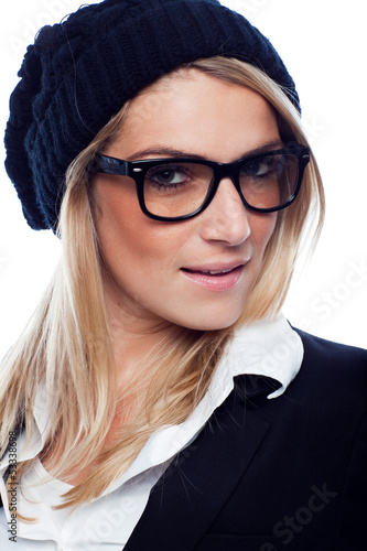 Beautiful woman in a beret and glasses