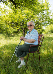 Old woman sitting on a chair