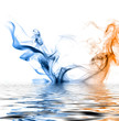 Blue and orange smoke reflected in the water surface.