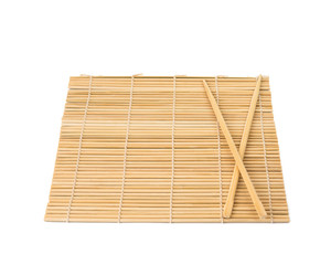 Series. chopsticks isolated on bamboo mat