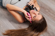 Woman lying on a floor with headphones
