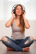Beautiful woman enjoy music in headphones