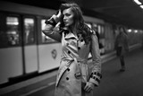 Woman in coat waiting for someone