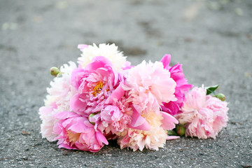 Bouquet of beautiful peonies on a road
