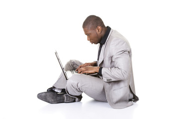 Successful businessman working on laptop