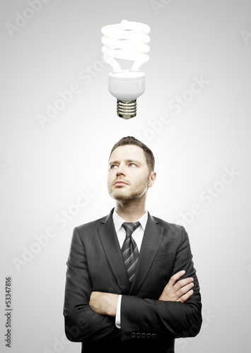 businessman and energy-saving lamp