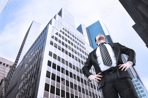 businessman and skyscraper - 53347820