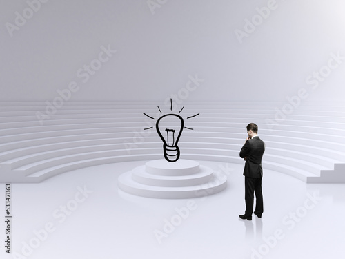 businessman looking on lamp