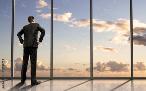 businessman standing in office - 53348035