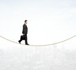 man walking on a rope