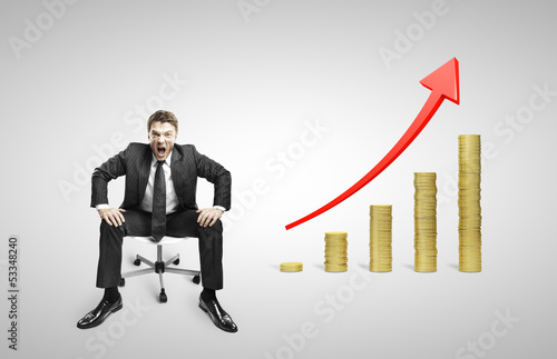 man sitting on chair and coins