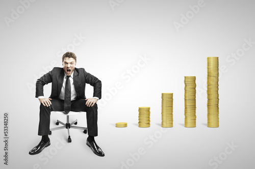businessman sitting on chair and coins