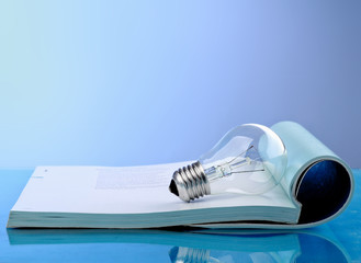 A book and lamp, blue photo
